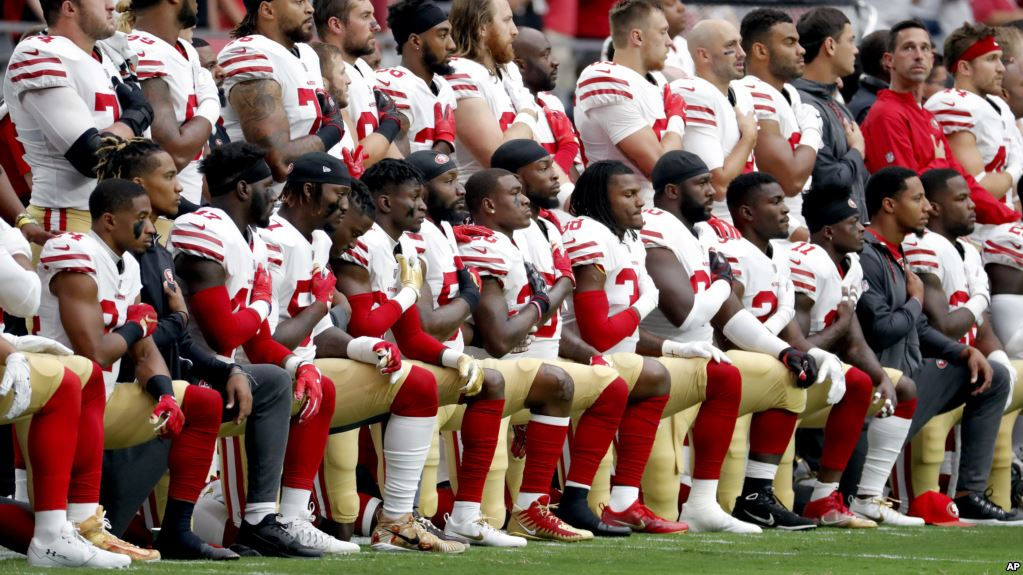 San Francisco 49ers take a knee during the national anthem