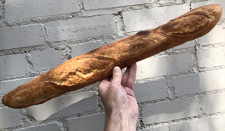 This is our baguette. Notice how, if you'd like to, you can throw it like a javelin. We think it's far too beautiful and delicious to be tossing it around like athletic apparatus, but go ahead and do what you do.