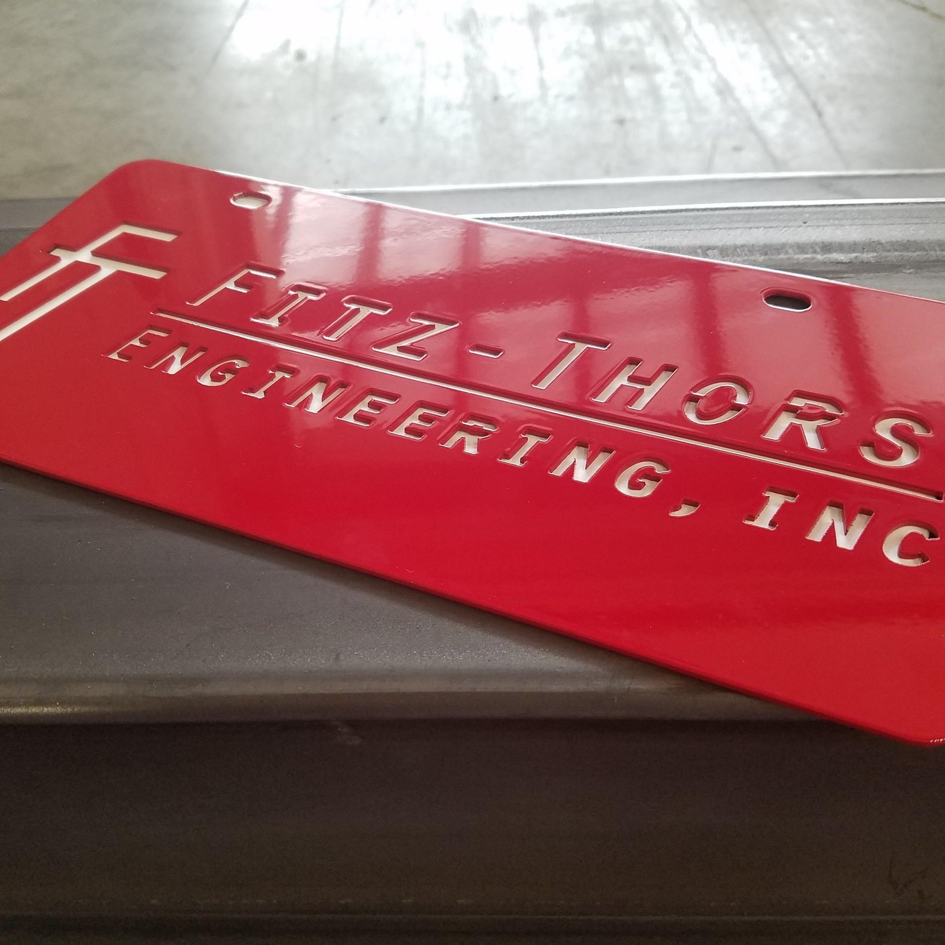 Fitz-Thors-Engineering_manufacturing_waterjet_logo_license-plate-2.jpg