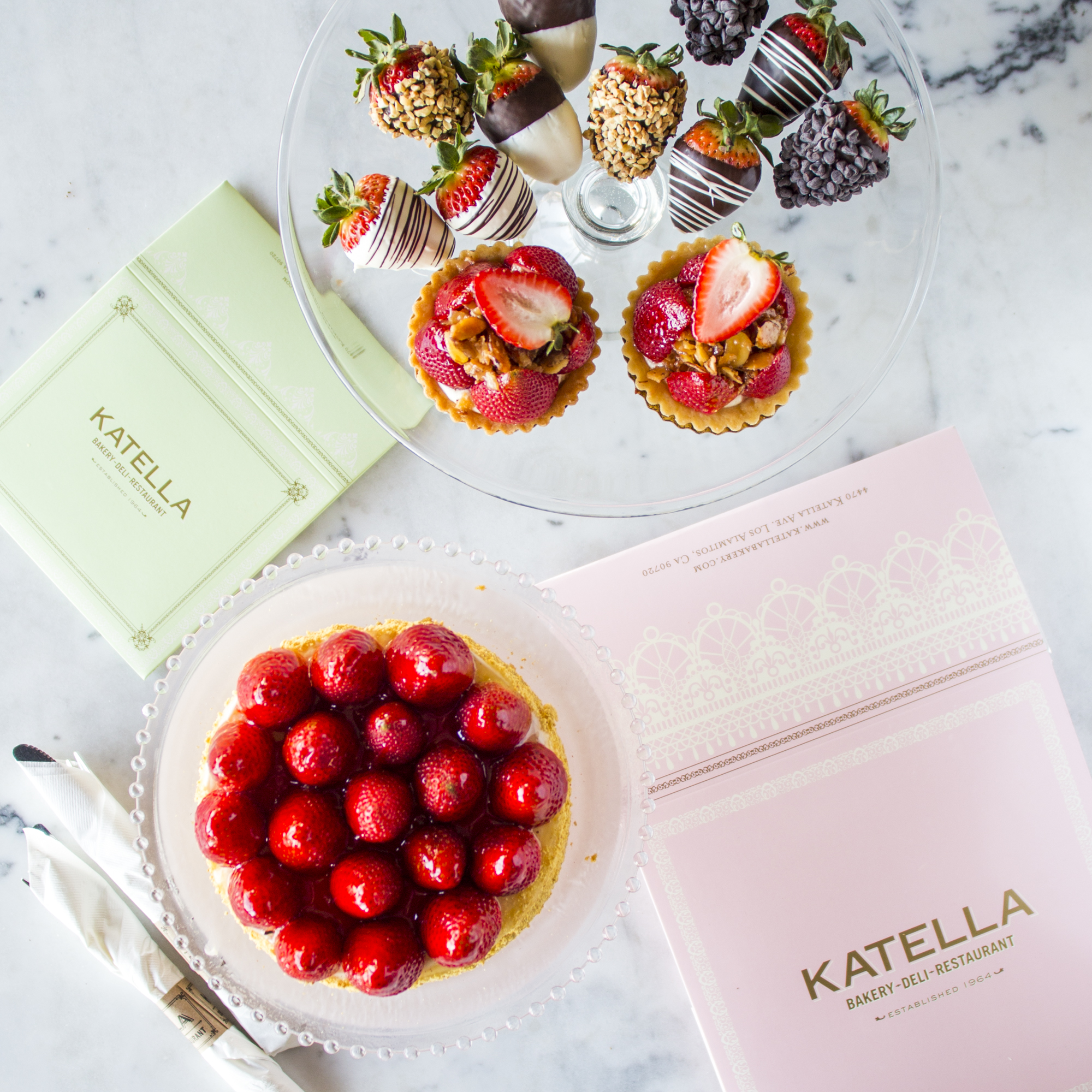 Katella Bakery display of specialty desserts highlighting fresh strawberries