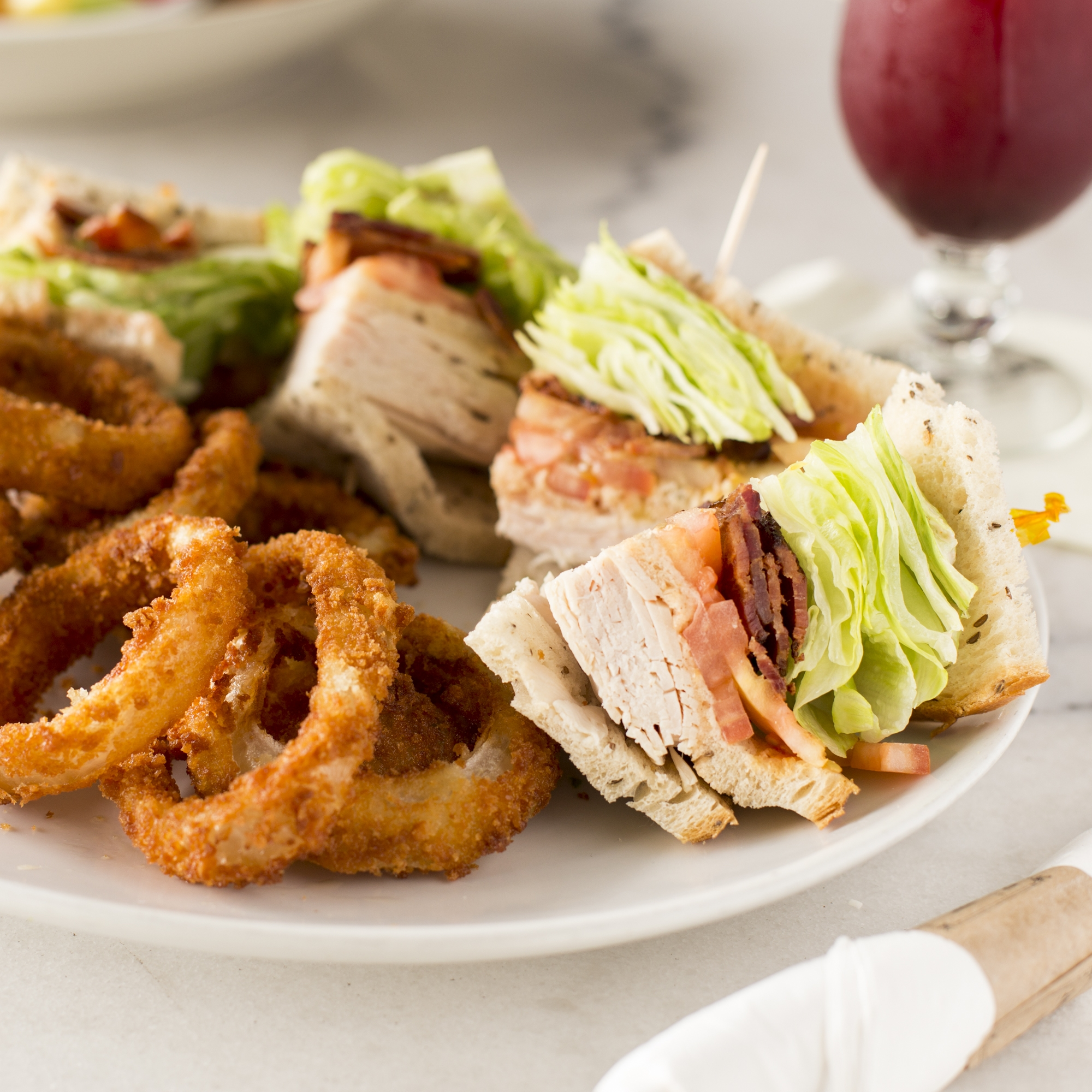 Katella Club Sandwich with onion rings
