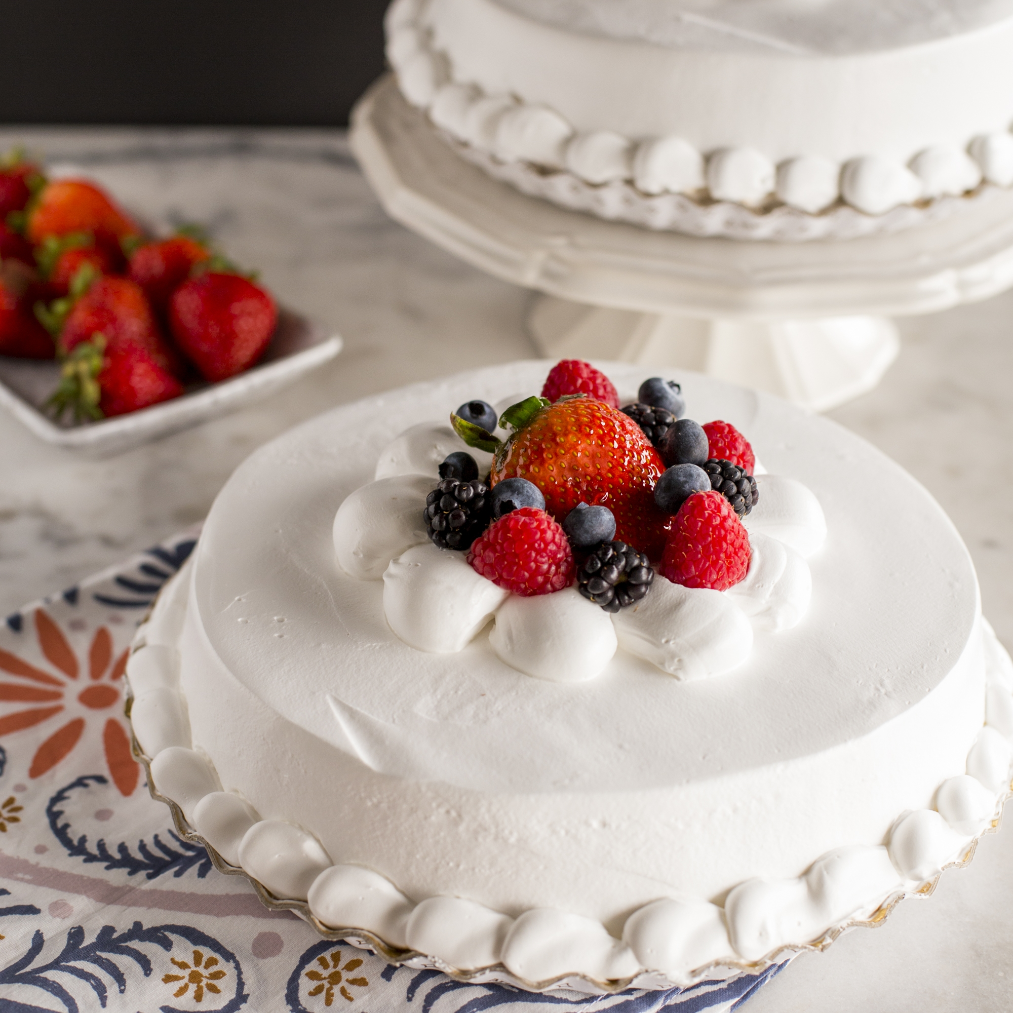 Katella Bakery specialty cake with fresh berries