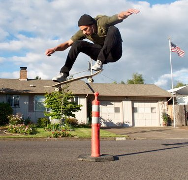 TeeJay ollie over house.jpg