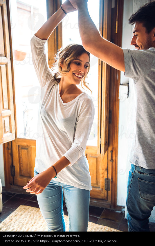2010578-happy-young-lady-dancing-with-man-calm-joy-couple-together-photocase-stock-photo-large.jpeg