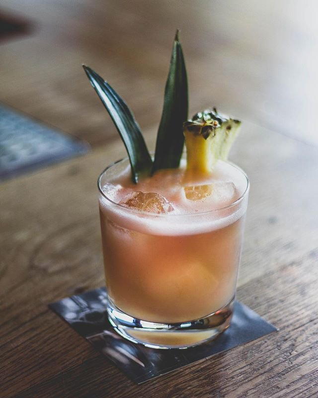 Concrete Jungle bird - A dark take on a tiki cocktail, the rum based Jungle Bird fuses tropical tastes of pineapple and lime with bitter Campari. Learn MoreIngredients:1/4 Oz - Demerara1/2 Oz - Lime Juice3/4 Oz - Campari1 & 1/2 Oz - Caramelized Pineapple Concentrate3/4 Oz - Appleton Reserve Jamaican Rum3/4 Oz - Chai Infused Jameson Black BarrelMix all ingredients with Ice in shaker