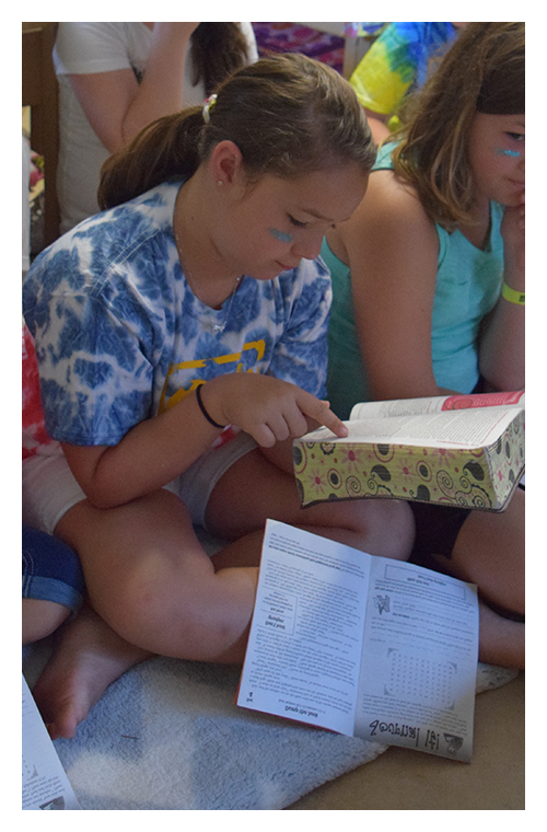 Little-Girl-Studying-at-Camp-2.jpg
