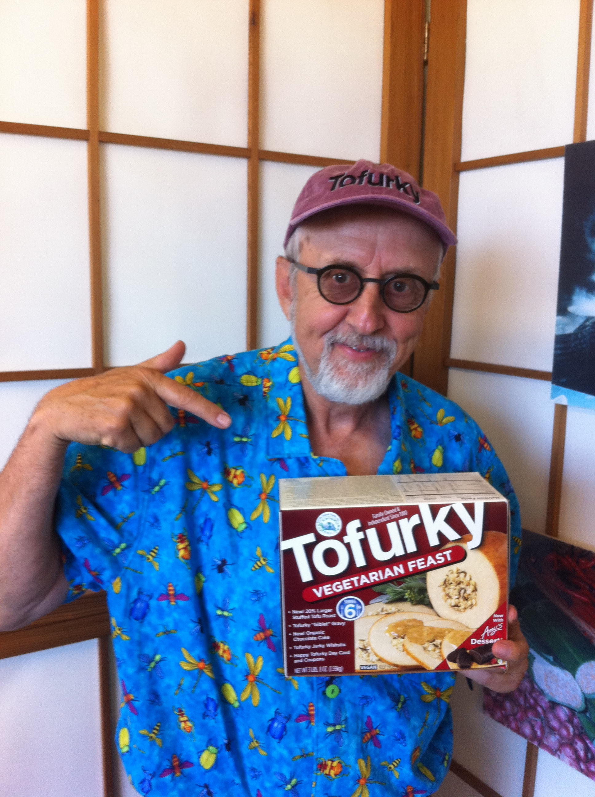 """SETH TIBBOTT - Seth Tibbott founded Turtle Island Foods, dba """"The Tofurky Company"""" in 1980 on $2,500, his life savings from his 8-year career as a teacher/naturalist in the Portland, Oregon public schools. The company's first product, tempeh (a fermented soy bean cake from Indonesia), was made and delivered in small batches to fledgling natural food stores in Portland and the west coast.The first 9 years in business were a financial struggle. America was not quite ready for tempeh yet and Seth's take-home pay averaged $290 for those years. Living the dream but losing his shirt, Seth rented four trees in 1984 near the tempeh shop for $25.00 per month and built a 3-story tree house in which he lived for the next 7 years.In 1995, the company's fortunes changed with the introduction of the first Tofurky roasts at Thanksgiving. 500 roasts were sold that year throughout the Pacific Northwest but soon a larger, national market came calling.Today, 38 years after its founding, Tofurky is still a family owned, independent enterprise and Seth is the company's Chairman and stepson, Jaime Athos is now CEO, carrying the dream forward. Tofurky is a model of """"slow growth"""" and is unique for never having any equity investment except for $17,000 from Seth's brother Bob in 1989. Today, Tofurky products are sold in over 21,000 stores worldwide on 6 of 7 continents and are made in a new eco production plant built to LEED Platinum standards. Seth has been overseeing Tofurky sales in the export market for the past 4 years which has afforded him the opportunity to witness firsthand the current explosion of veganism throughout the planet."""