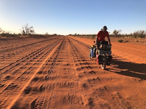 Henley (and 350 pounds) trekking along the sandy and corrugated Tanami road for 17 days.