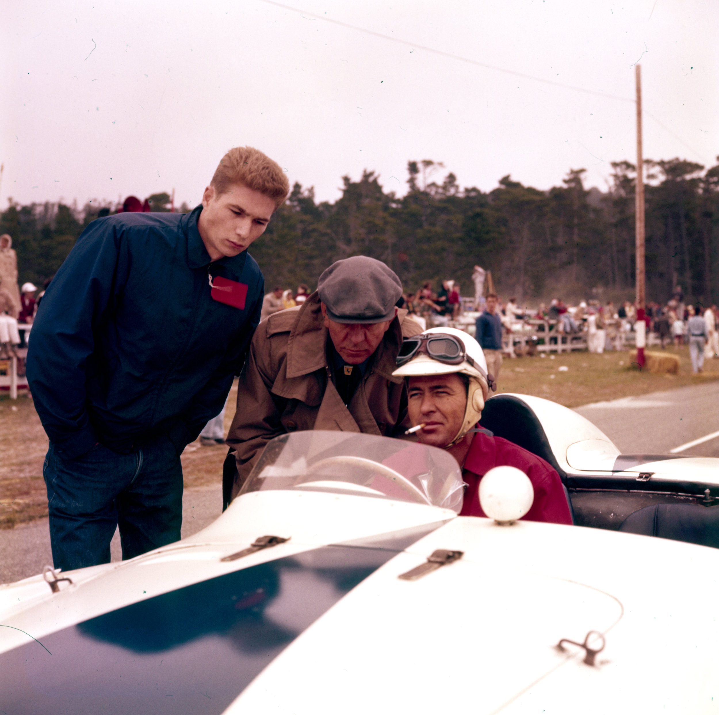 Carroll Shelby in car   Pebble Beach 1956, texan, Carroll Shelby is shown here in Allen Guiberson's 750 Monza with a 21-year-old Texas oilman named Jim Hall (on left).
