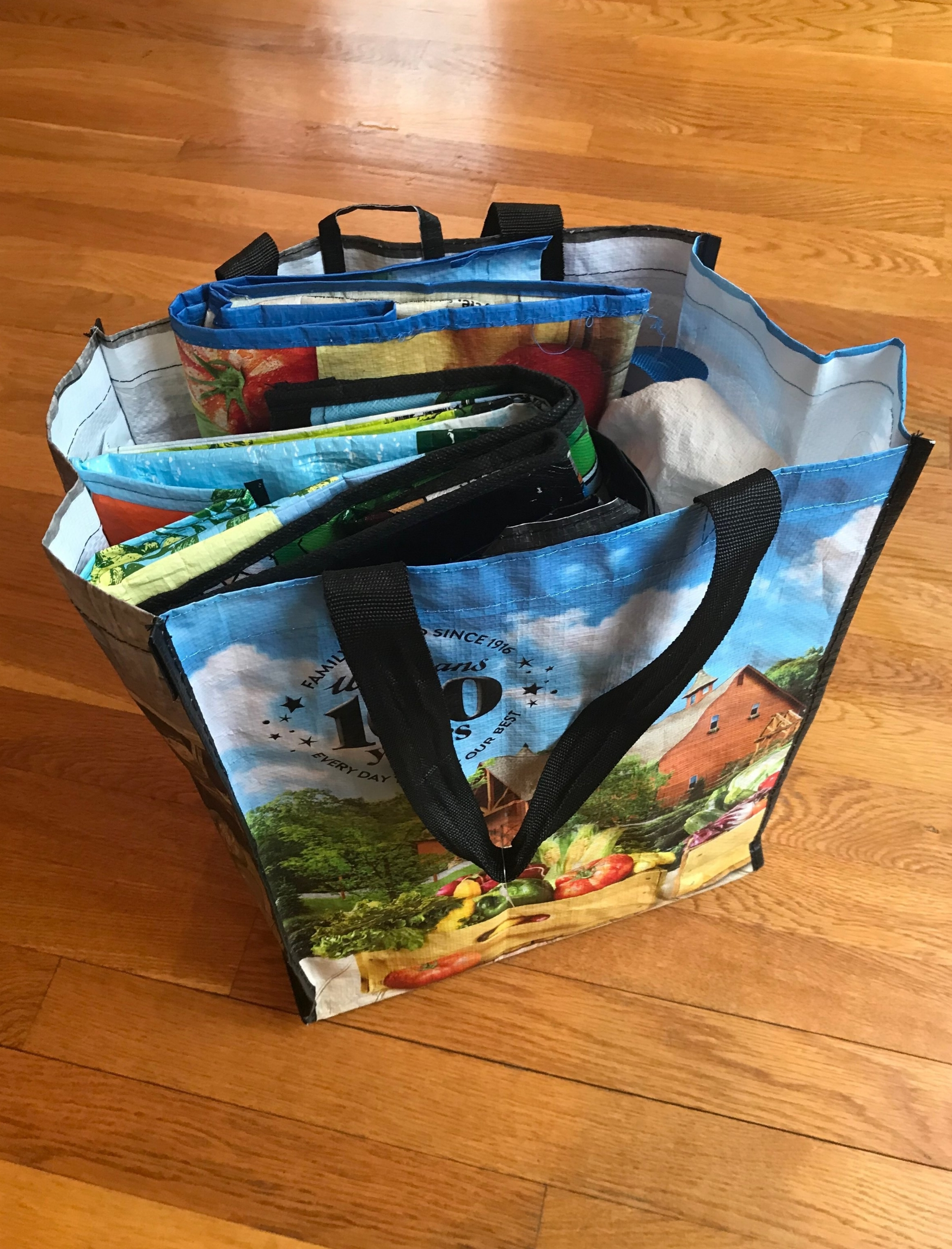 I keep my shopping bags,produce bags, and bulk bags altogether within one bag hanging in my mud room. Sometimes, I also leave a few bags in my trunk for last minute shopping trips.