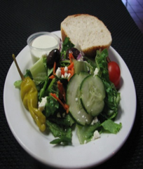 garden salad with bread by delectables