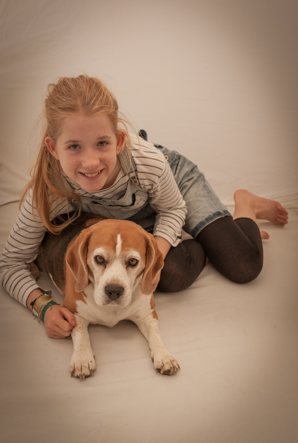 Child portrait with beagle dog in London