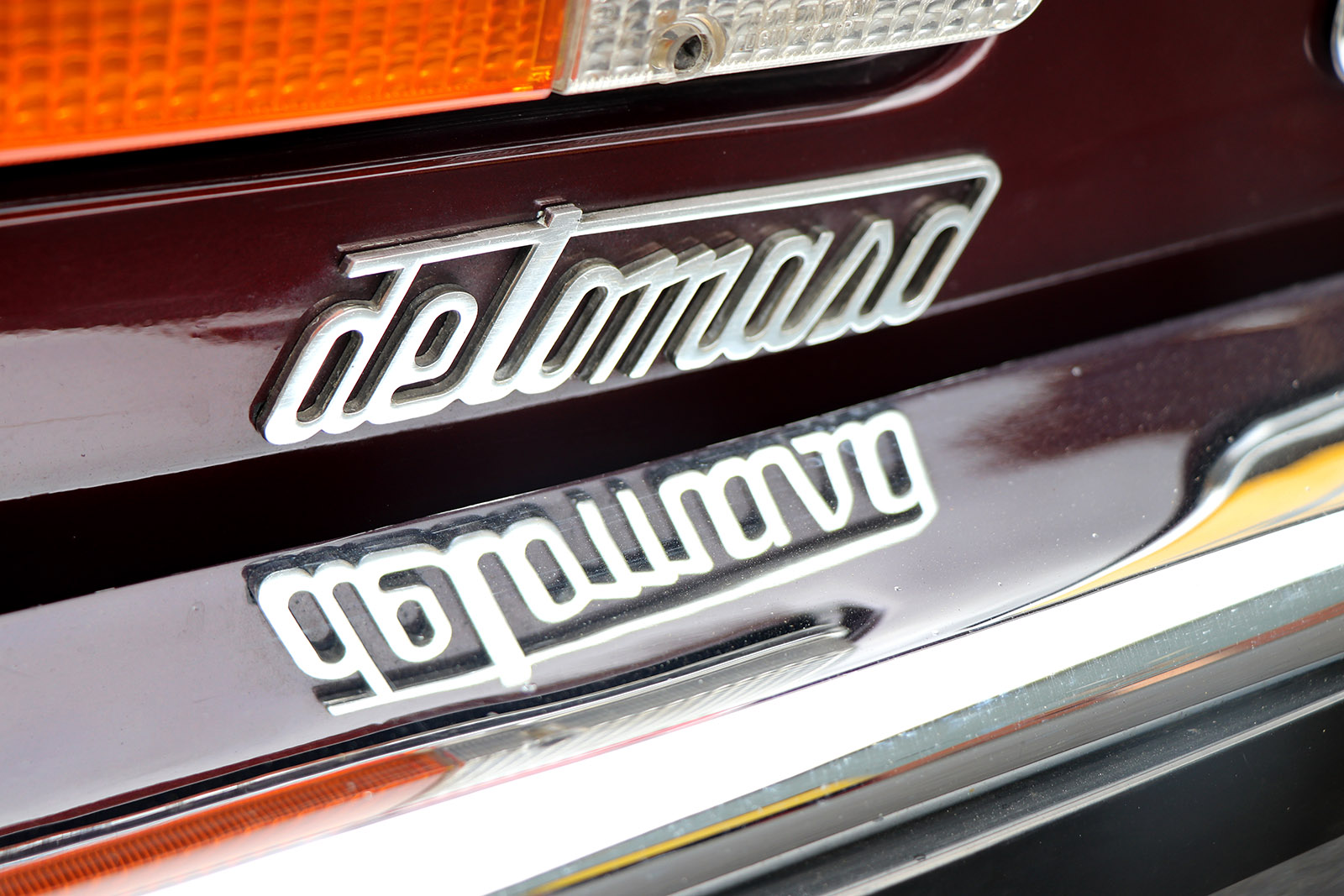 1982 series 2 burgundy deauville de tomaso badge web.jpg