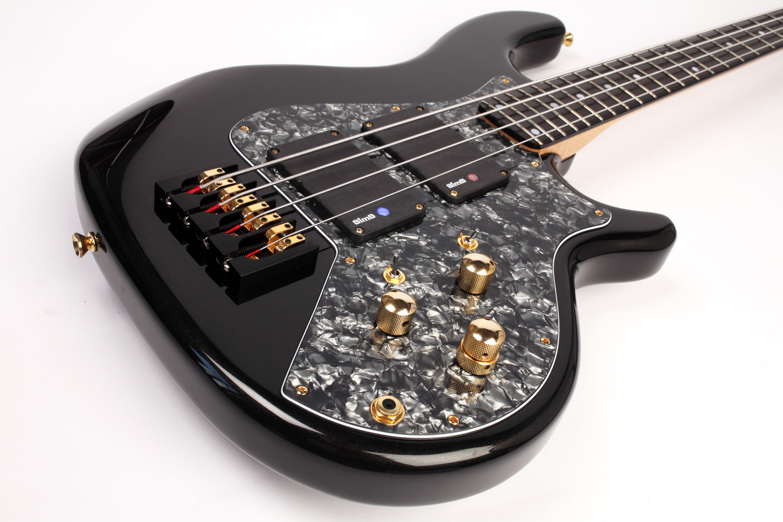 Black gold pearl high gloss polish Enfield Lionheart bass guitar with 2 band Glockenklang onboard preamp, Sims Super-Quad pickups and Hipshot hardware bridge.