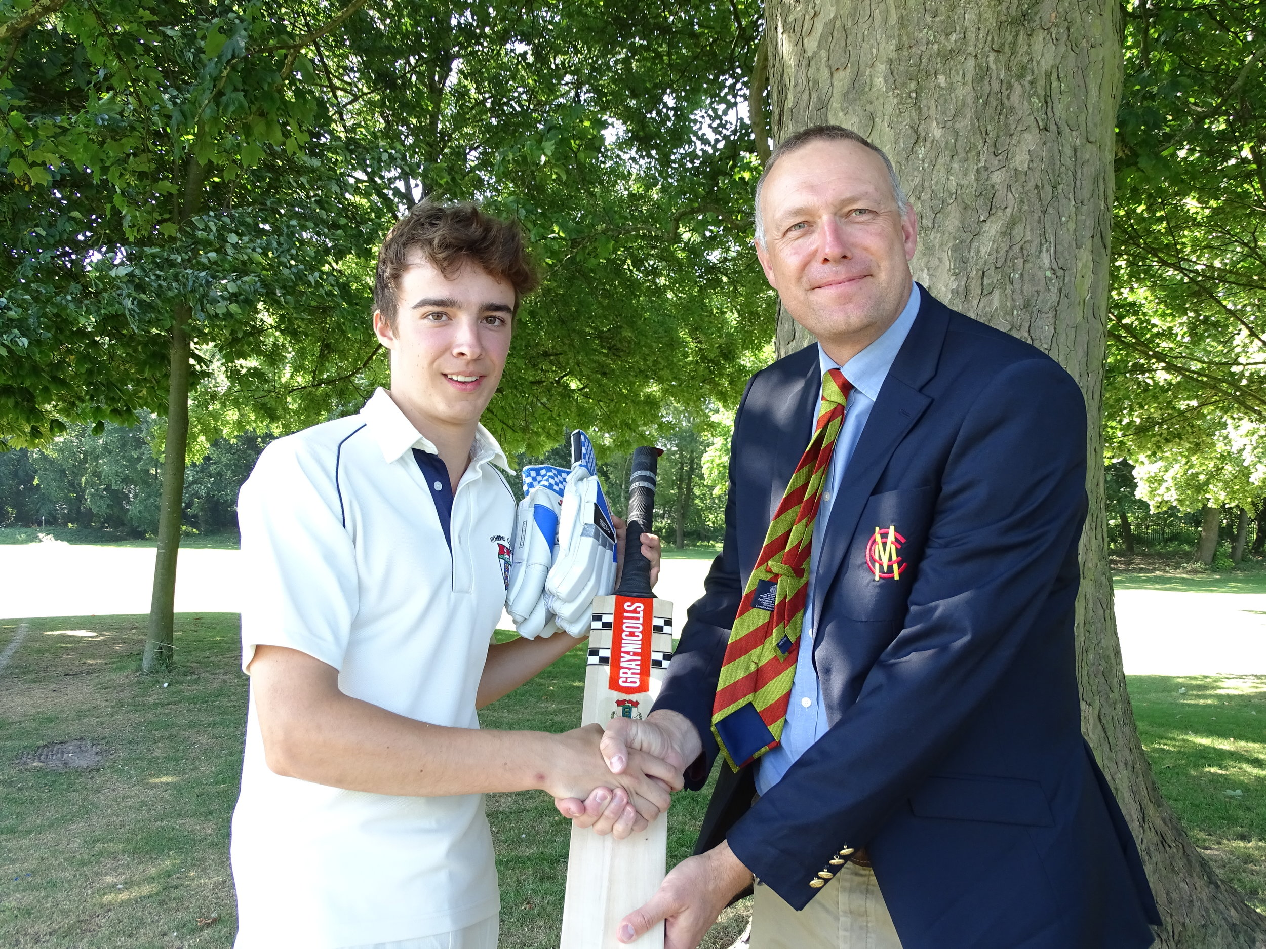 Henry receives his commemorative bat and gloves