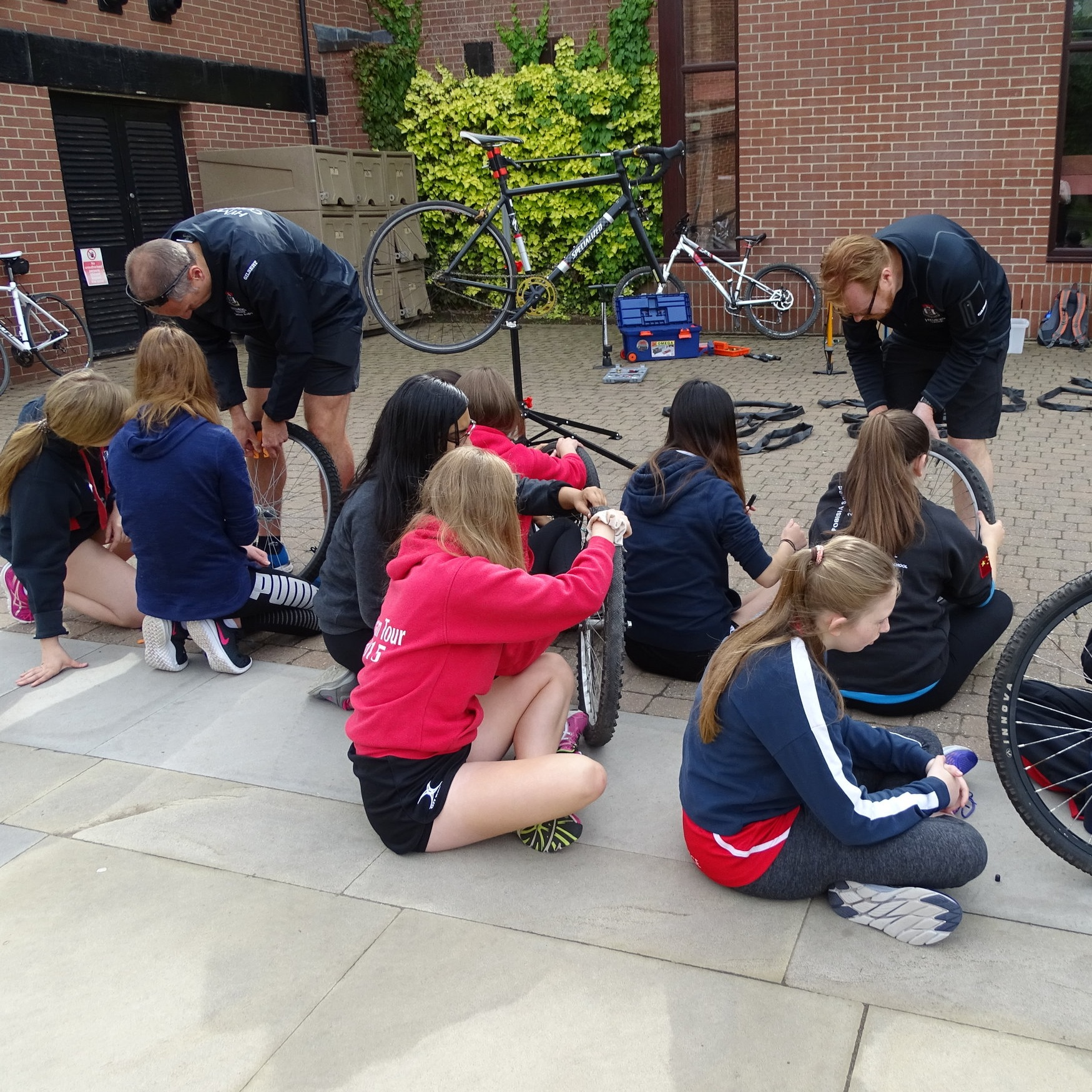 Some students were given a practical lesson in bike maintenance.