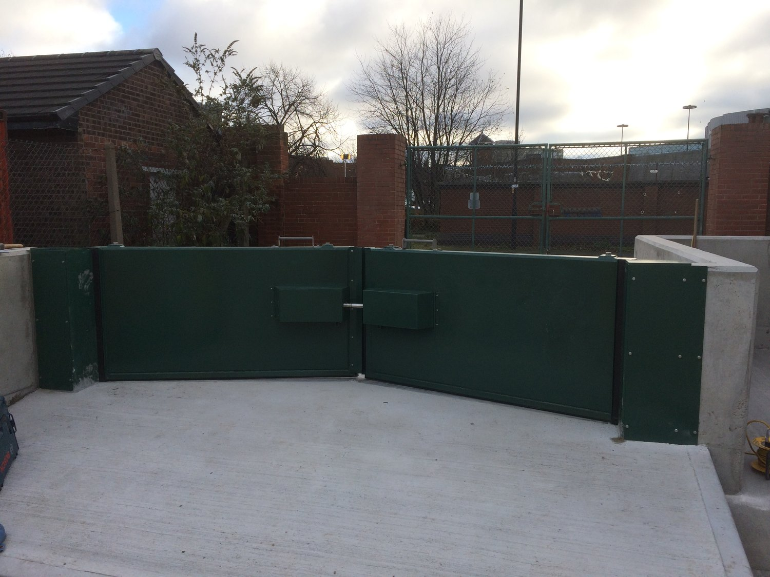 A manually operated double flood gate installed as part  of a flood protection scheme.
