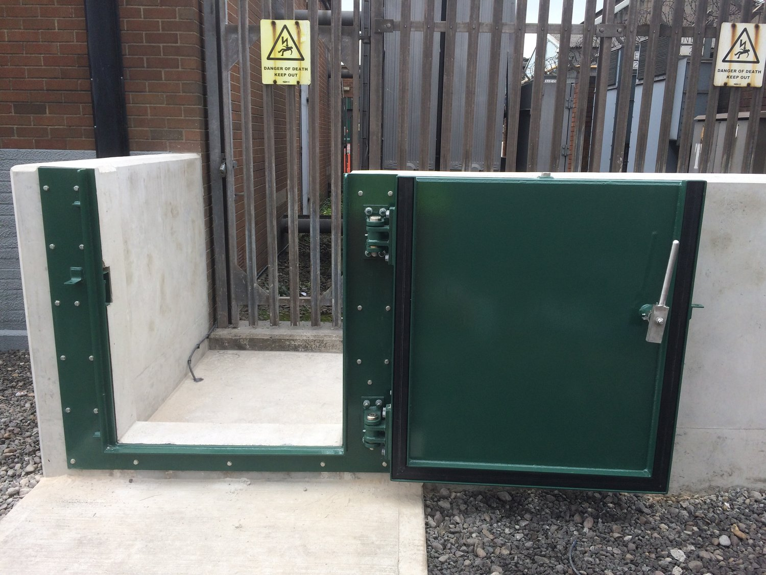 A pedestrian flood gate defending the power  supply to an industrial estate.