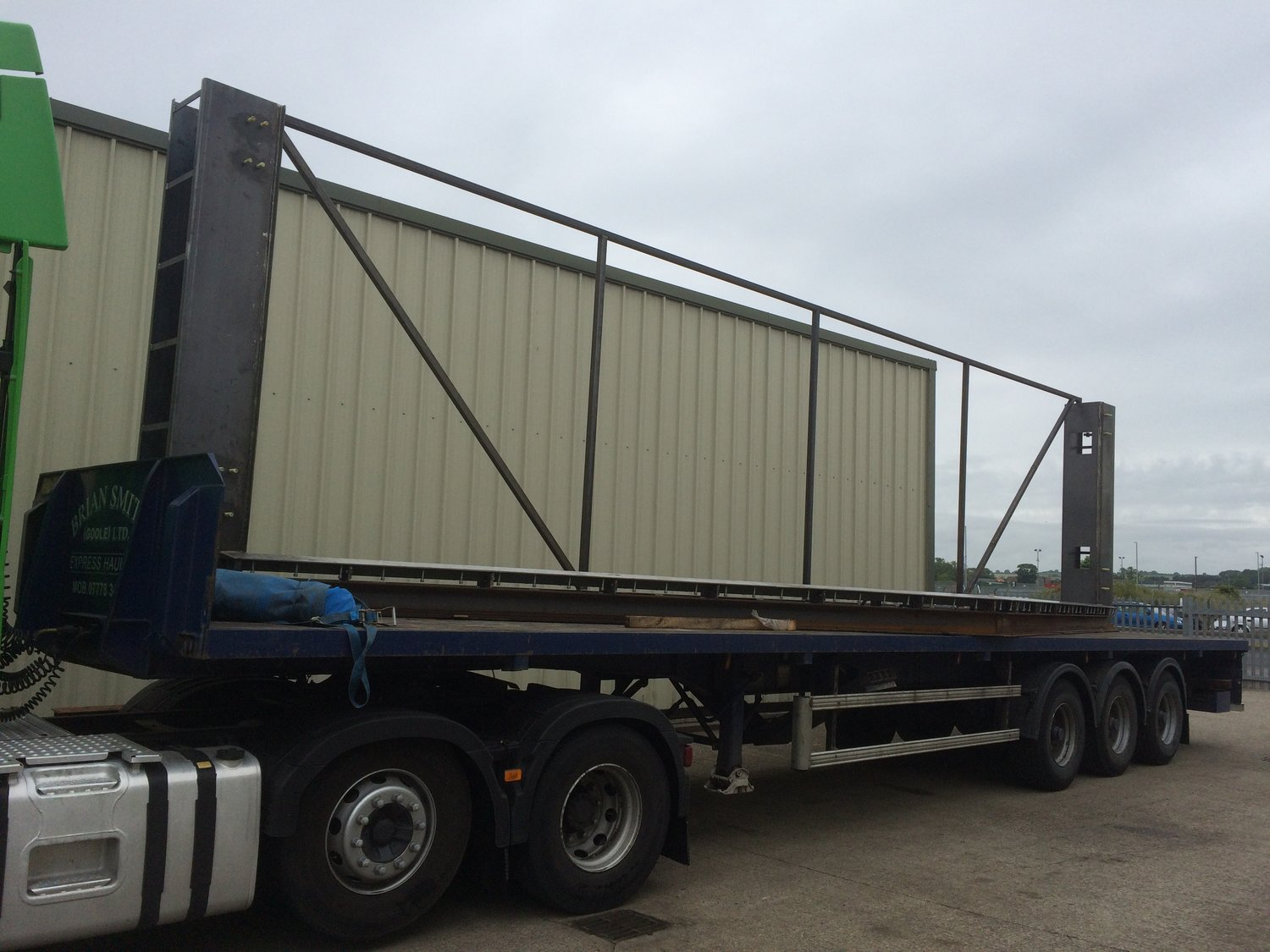 Ready for site. The 1st part of our installation  service. A lorry loaded with the frame for a  double flood gate.