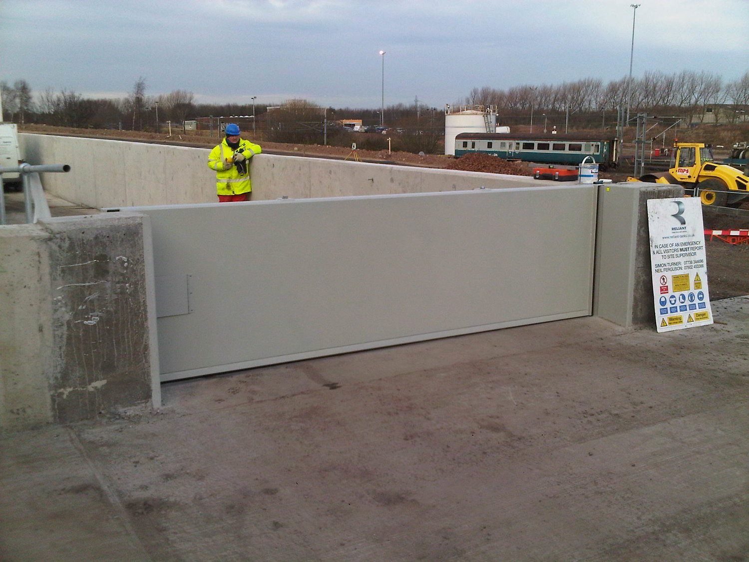 1st Defence Fabrications confirming the  installation of flood gate.
