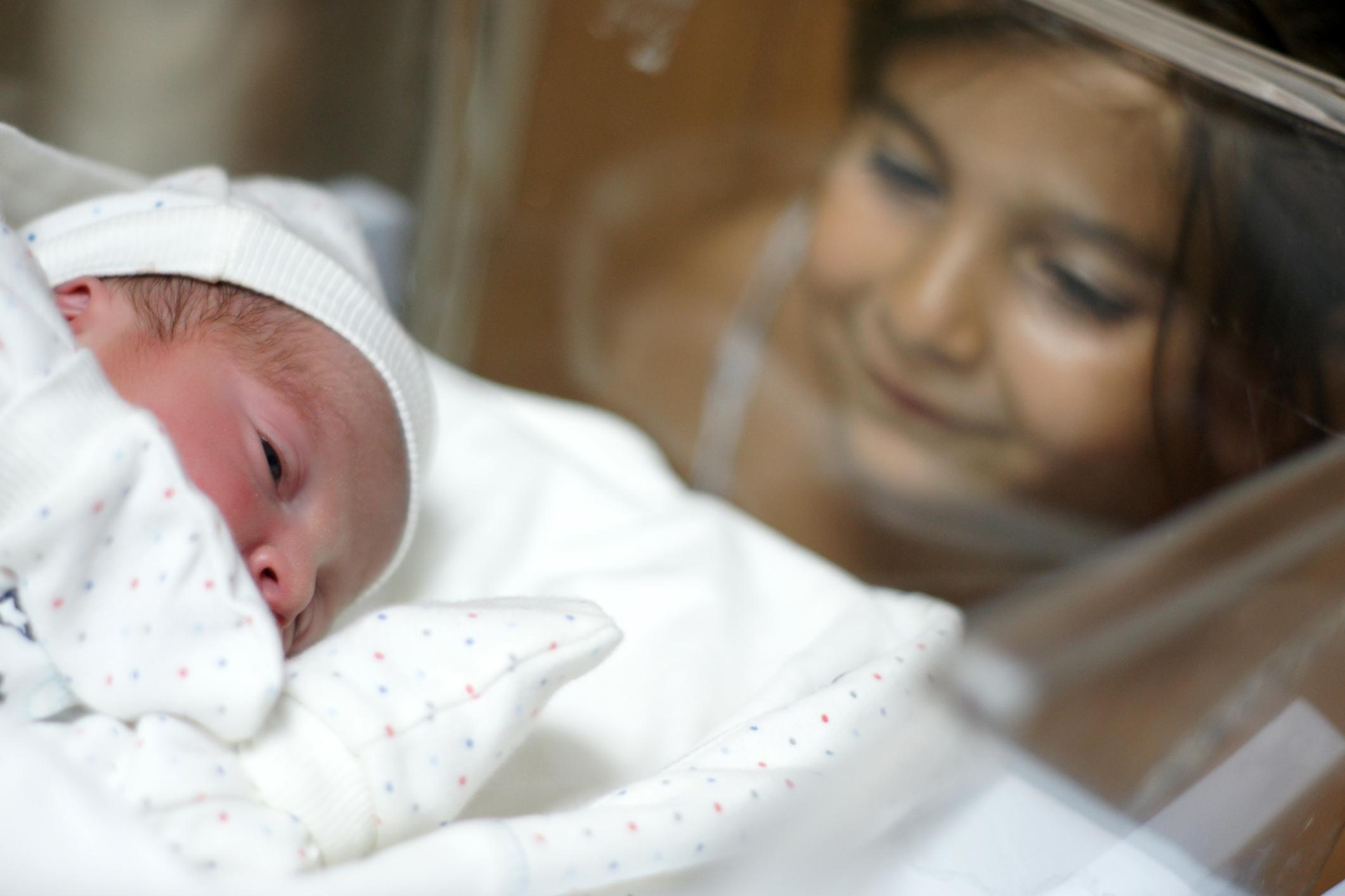 Little-girl-watching-her-newborn-brother-173713724_2122x1415.jpeg