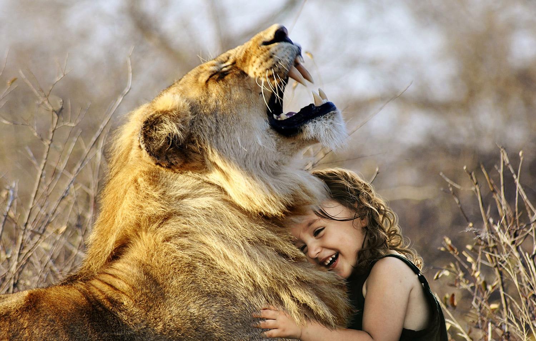girl hugging lion.jpg