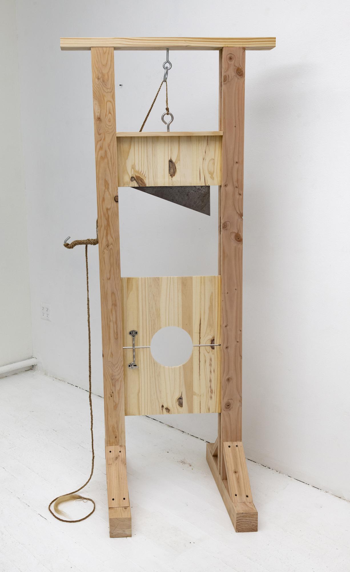 Chiara Ibrah,  Huntsville Amputation , 2018. Hair, wood panel, and rusted steel. 76.75 x 33 x 34 inches.