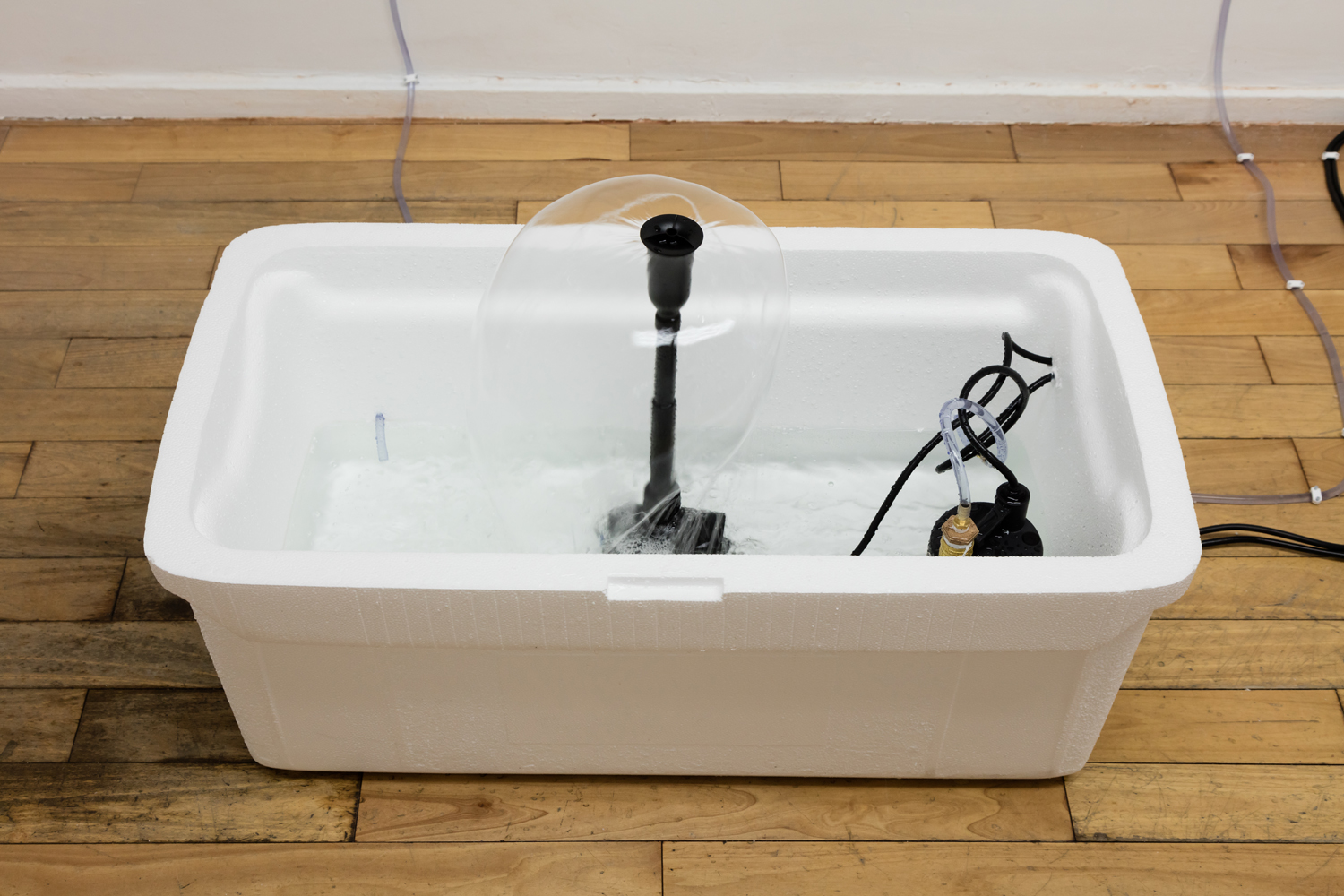 Phoebe Berglund in collaboration with Arkadiy Ryabin,  Huskee Fountain,  2019. Styrofoam, plastic fountain, vinyl tubing. 23.5 x 36 x 19 inches.