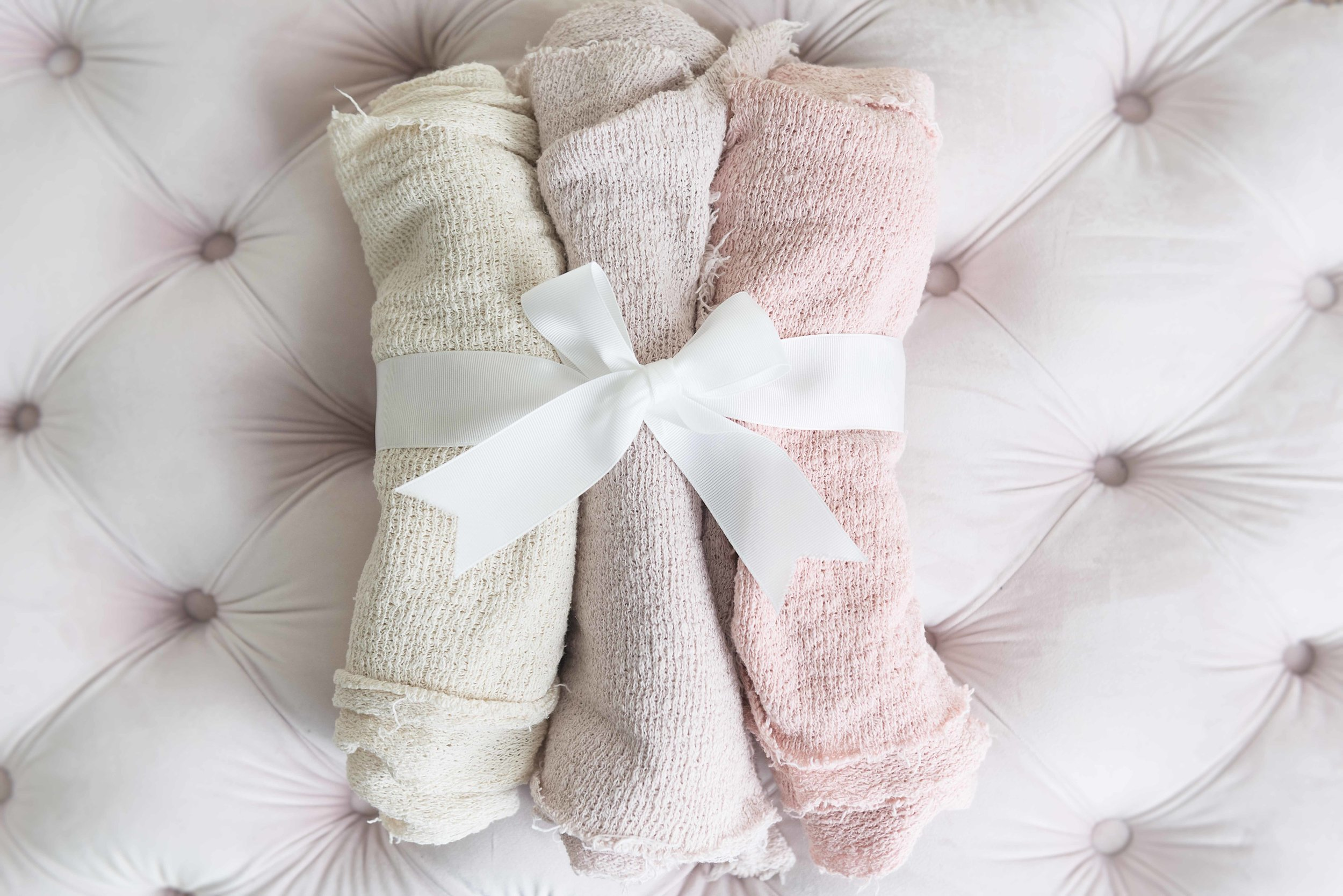 Our organic, textured newborn swaddles in neutral, lavender, and light pink