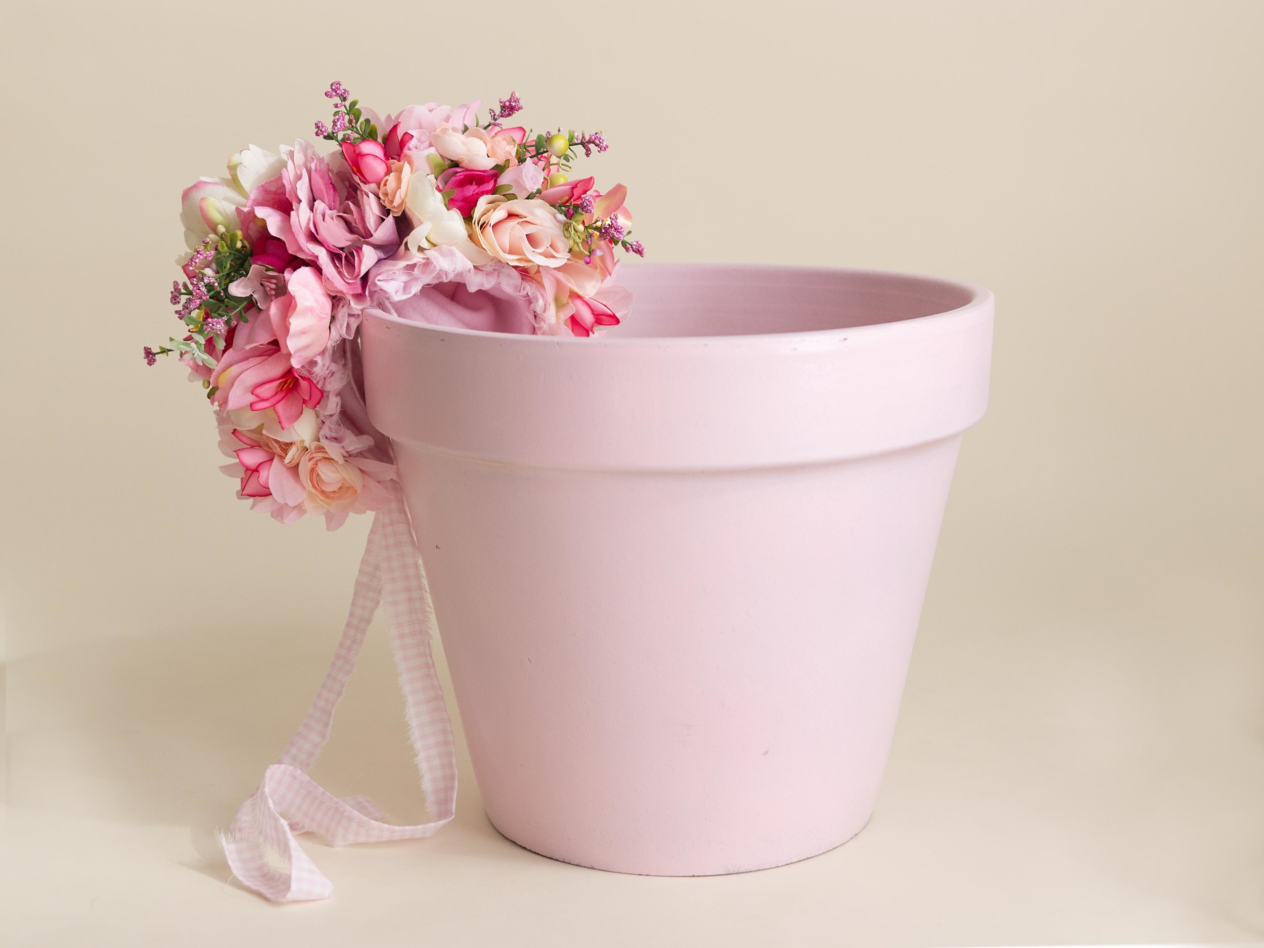 One of our most popular props for baby girls is this flower pot and flower bonnet.  The girls look darling in the pot with the flower bonnet on.