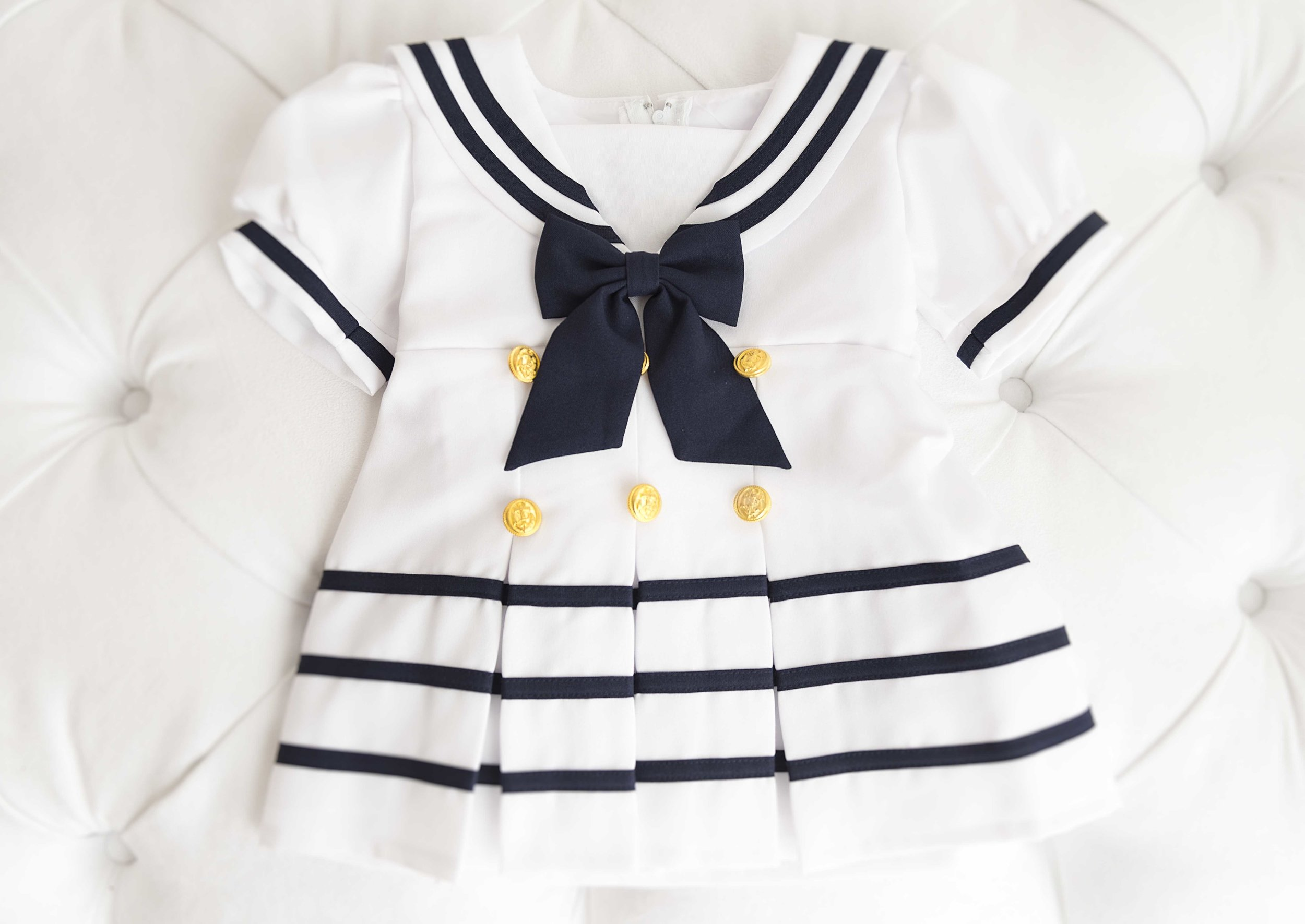 A sweet sailor outfit for your little girl because her first year will sail by so fast.
