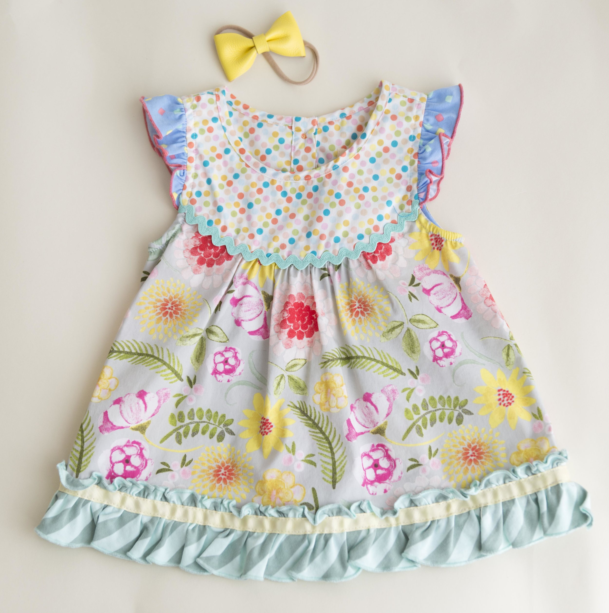 We have several darling Matilda Jane Clothing dresses and rompers with beautiful matching bows in our studio for your use.