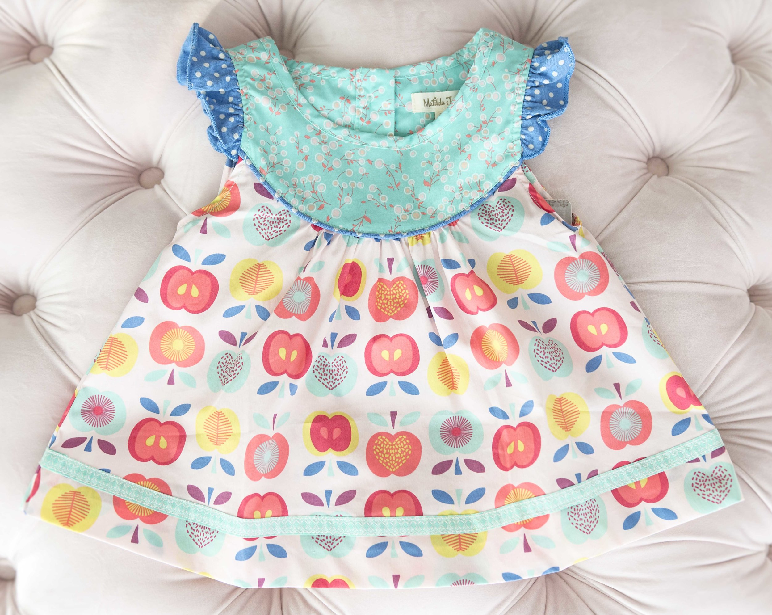 We have several darling Matilda Jane Clothing dresses in our studio for your use including this precious apple print dress.