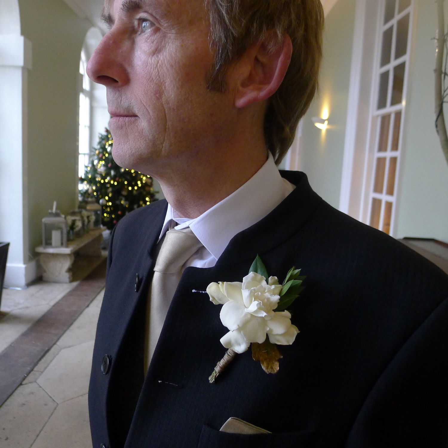 buttonhole with gardenia, myrtle, rosemary and an oak leaf