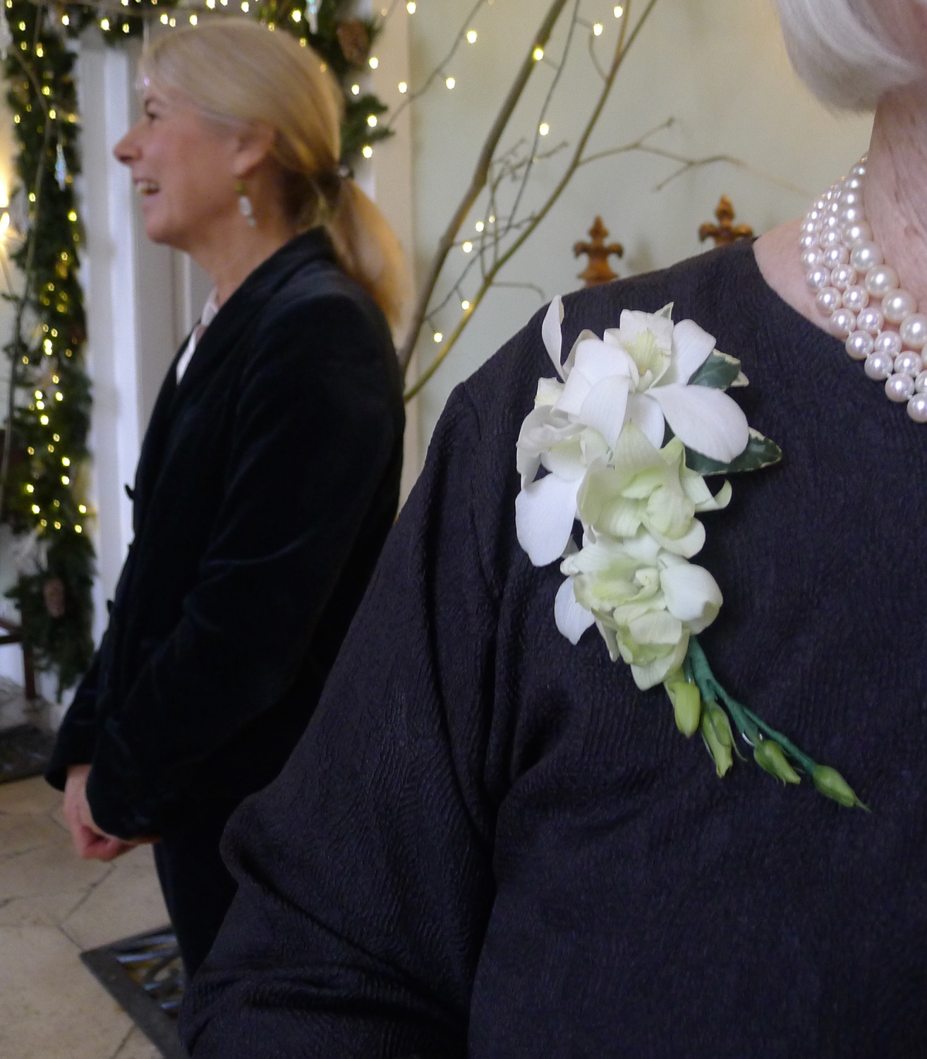 corsage of dendrobium orchids and ivy leaves