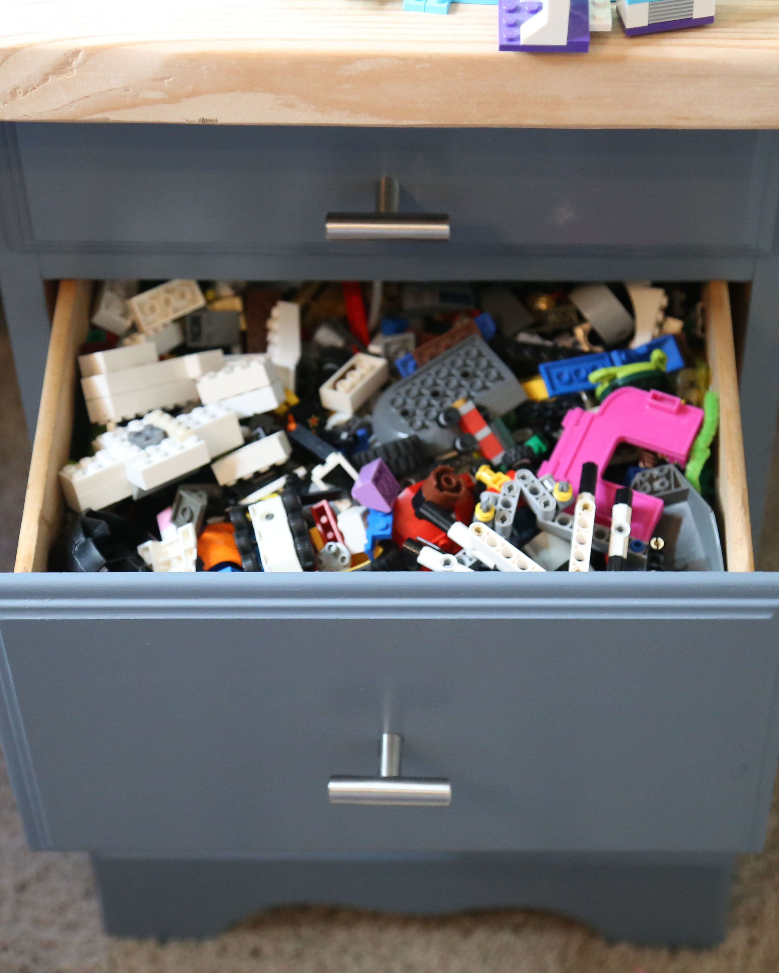 LEGO STORAGE: We found 2 matching nightstands at the thrift store too.  A little paint and new hardware and we had lego storage for under $30.