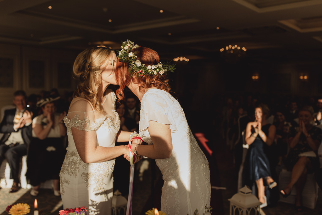 two brides kissing at crover house