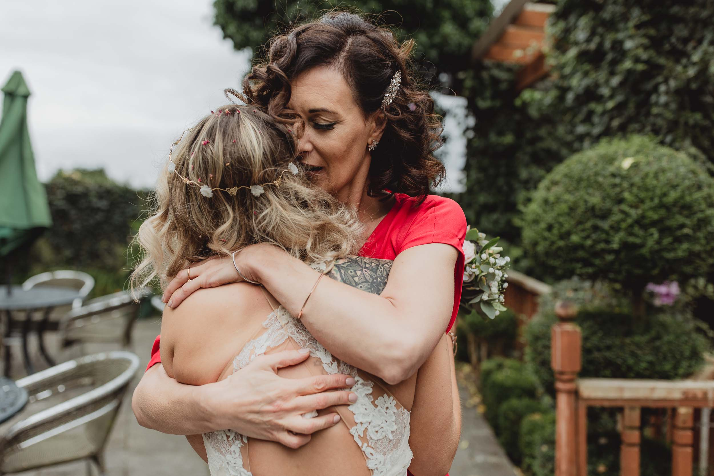 mum hugging her daughter at her wedding in cloonacauneen castle in galway
