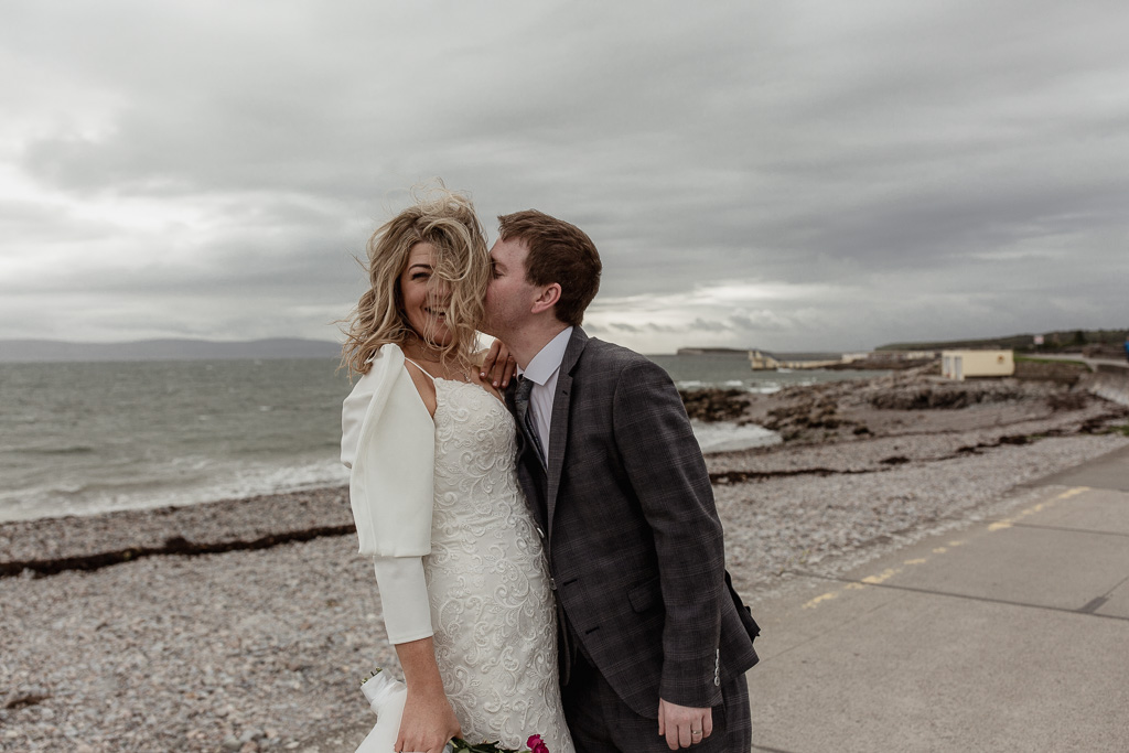 Couple kissing on salthill, galway wedding.