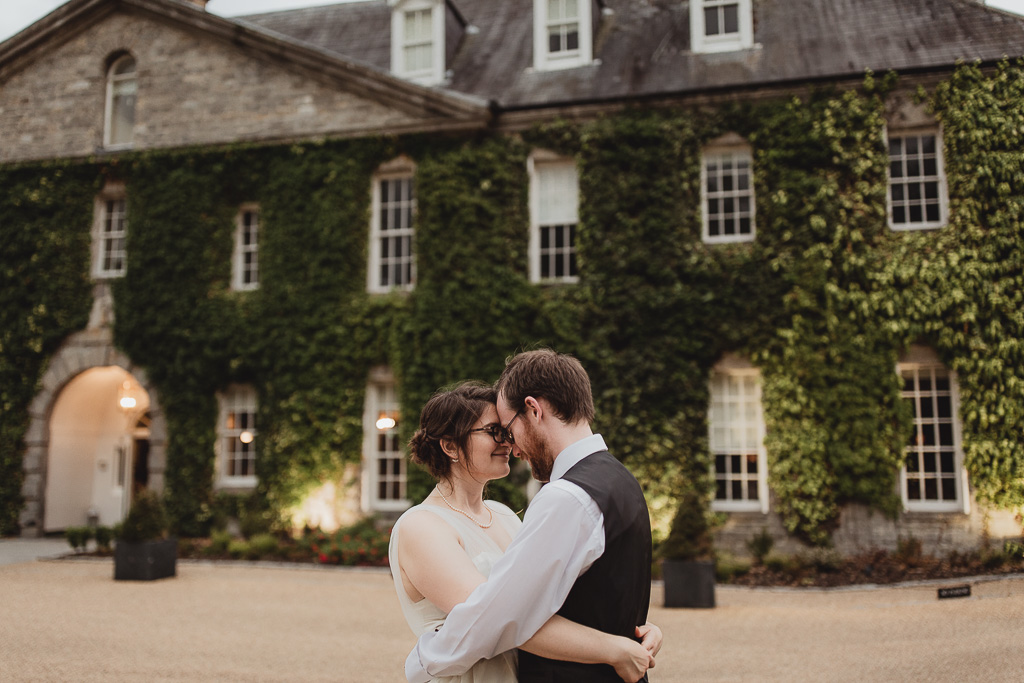 Married couple hugging outside Celbridge Manor Hotel