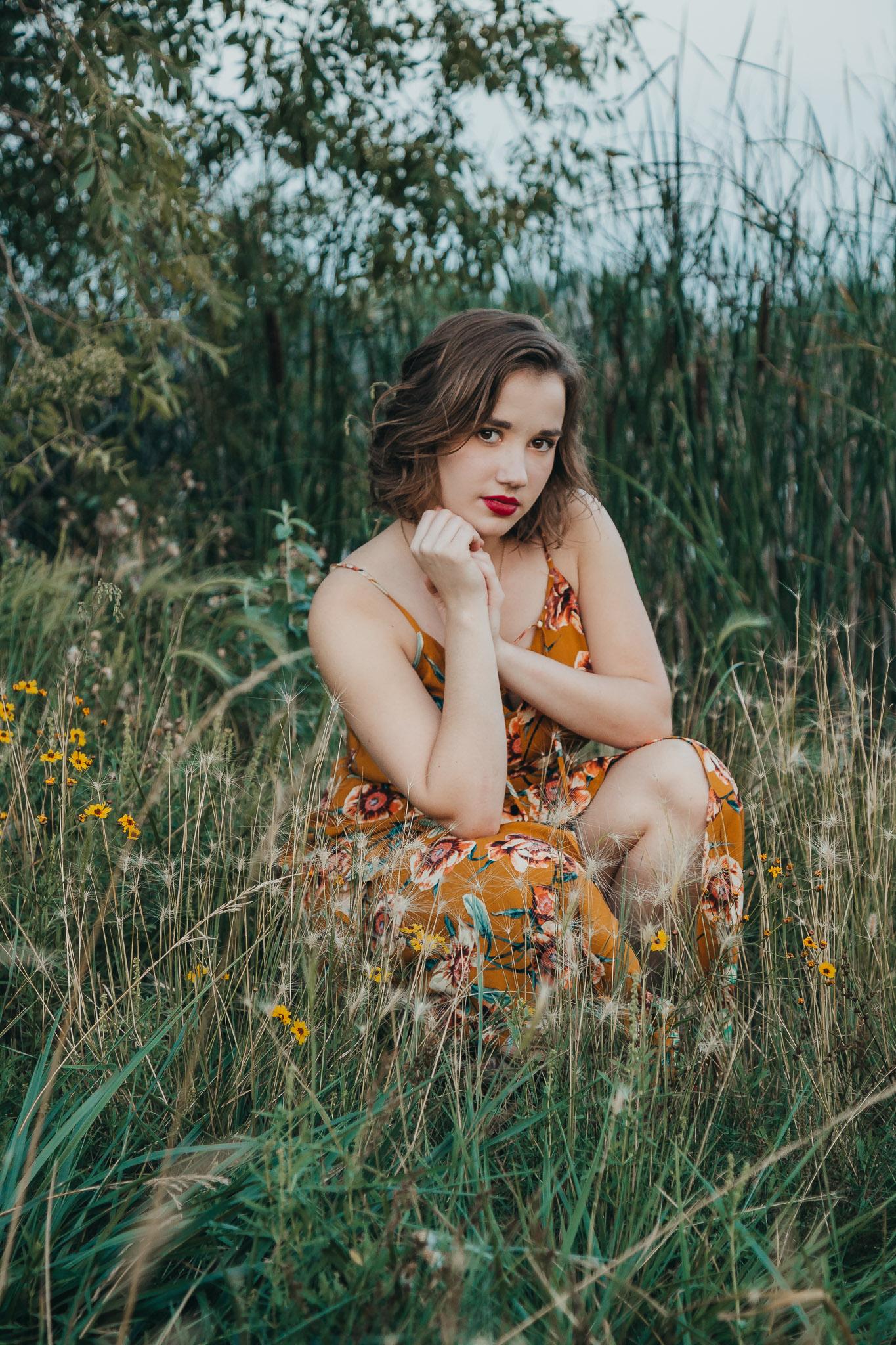 senior girl in flower field