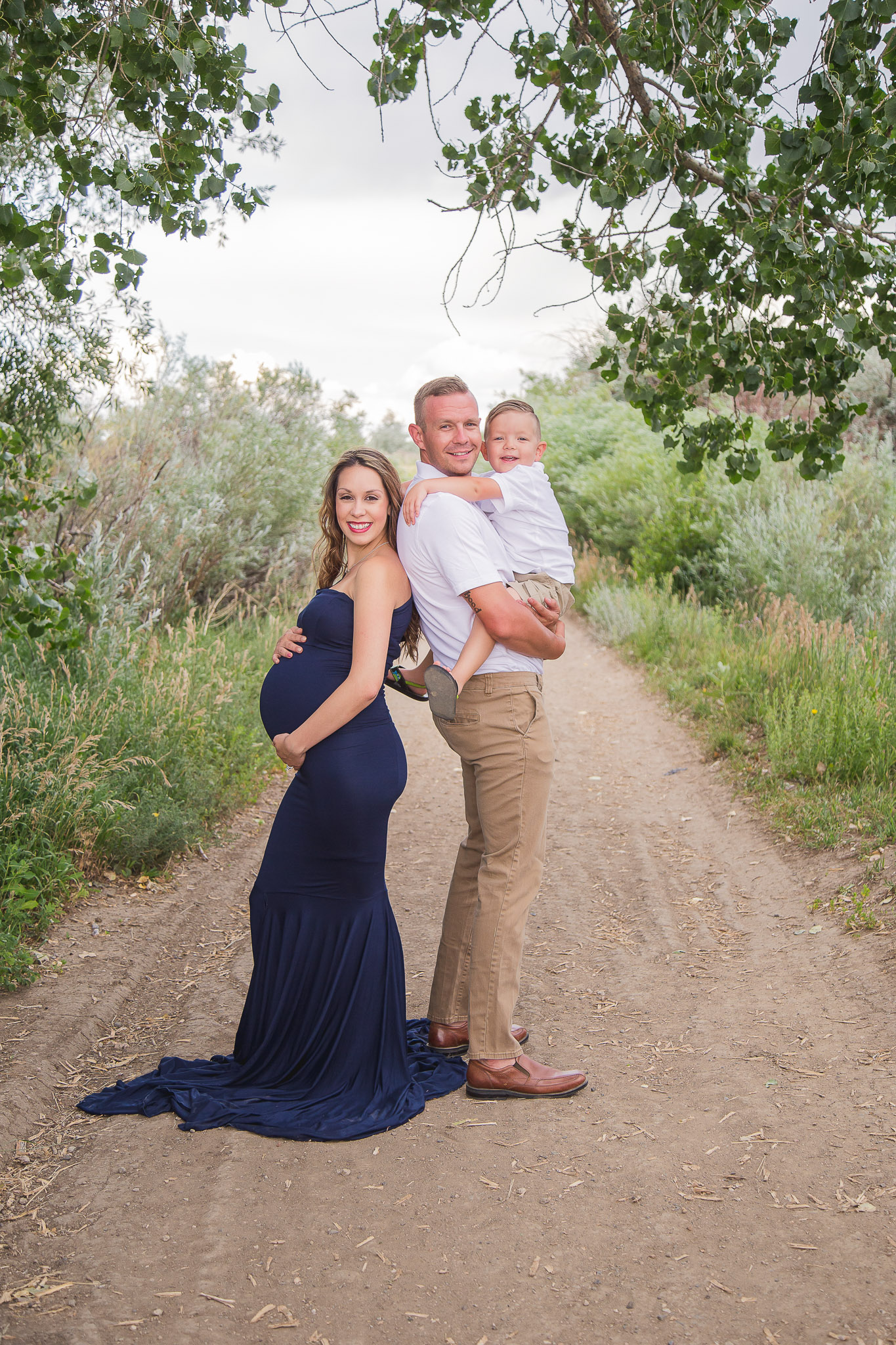 Maternity-Family-with-Toddler-Outside-Gown.jpg