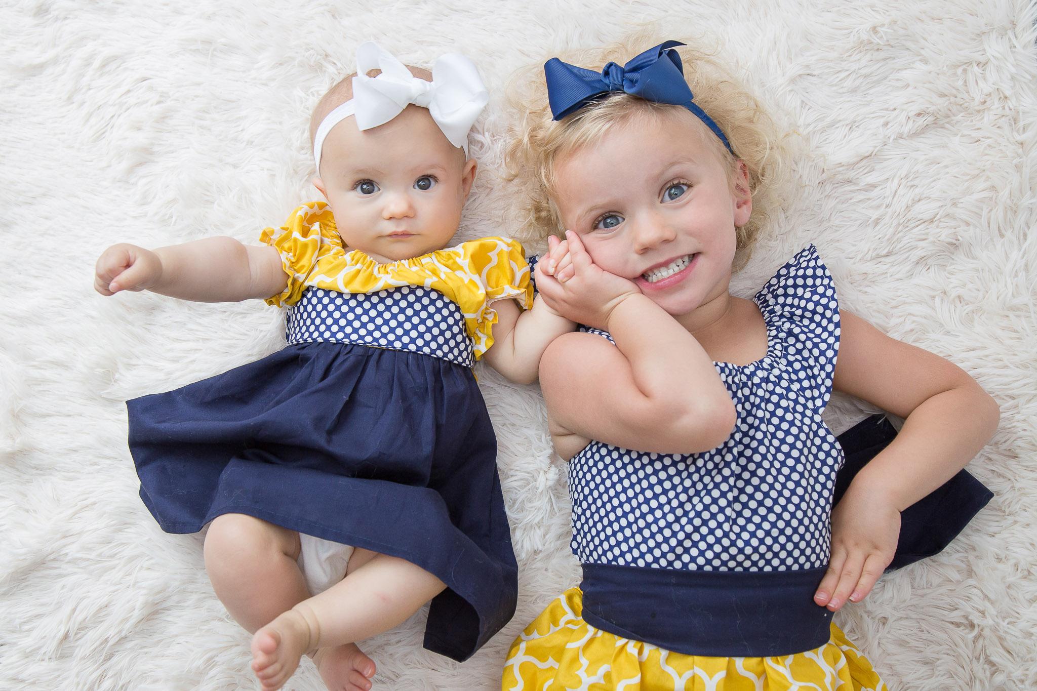 toddler-baby-sister-photo-navy-yellow.jpg