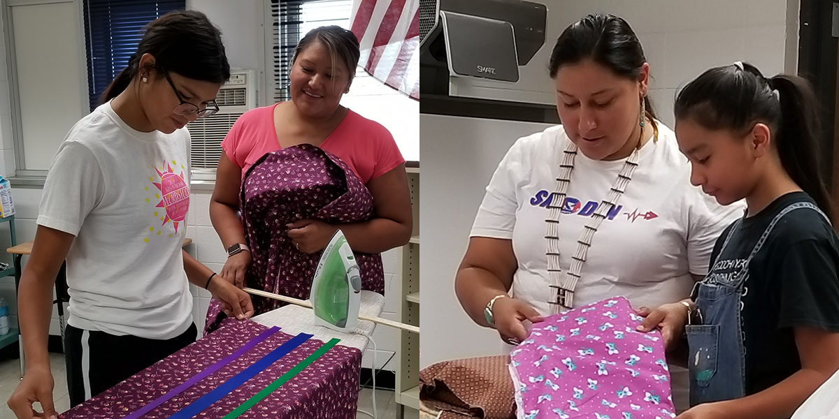 Josie Felix, Shannon Uses The Knife, Margaret Landin and Sophie Landin at a Ribbon Skirt workshop in White Shield. This was a collaborative project between the Arikara Community Action group and the Culture & Language Division to provide summer activities for youth in the White Shield community.