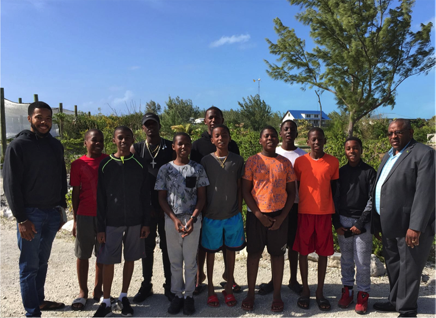 The Young Men's Leadership Program with The Honorable Hank Johnson on The Island School campus. (From left to right: Stan Burnside, Shicardo Knowles, Ethan Forbes, Theondre Ferguson, Kiyano Butler, Alex Young, Nathan Cambridge, Tashon Hall, Demiko Pratt, Alvanno Winder, Clement Thompson Jr., Hon Hank Johnson)