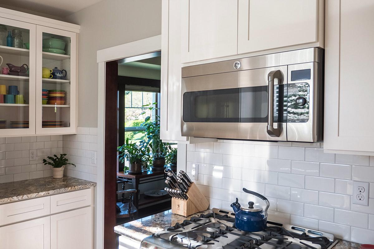 sipes-kitchen-microwave-livingroom-view.jpg