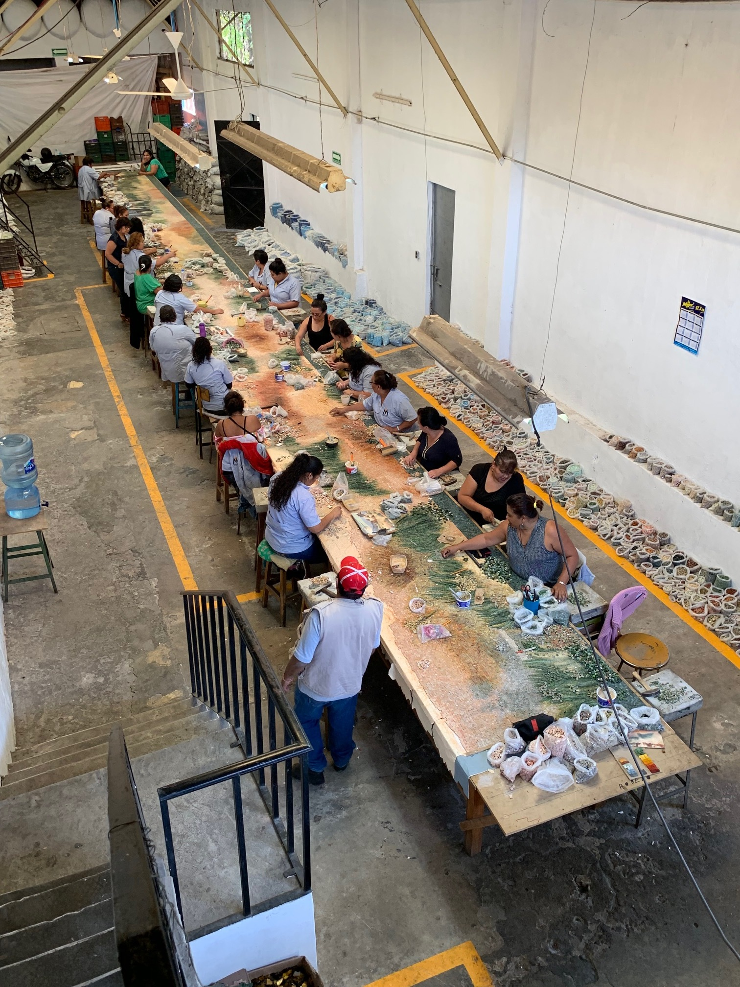 The talented artisans behind the creation of this mosaic tile mural.