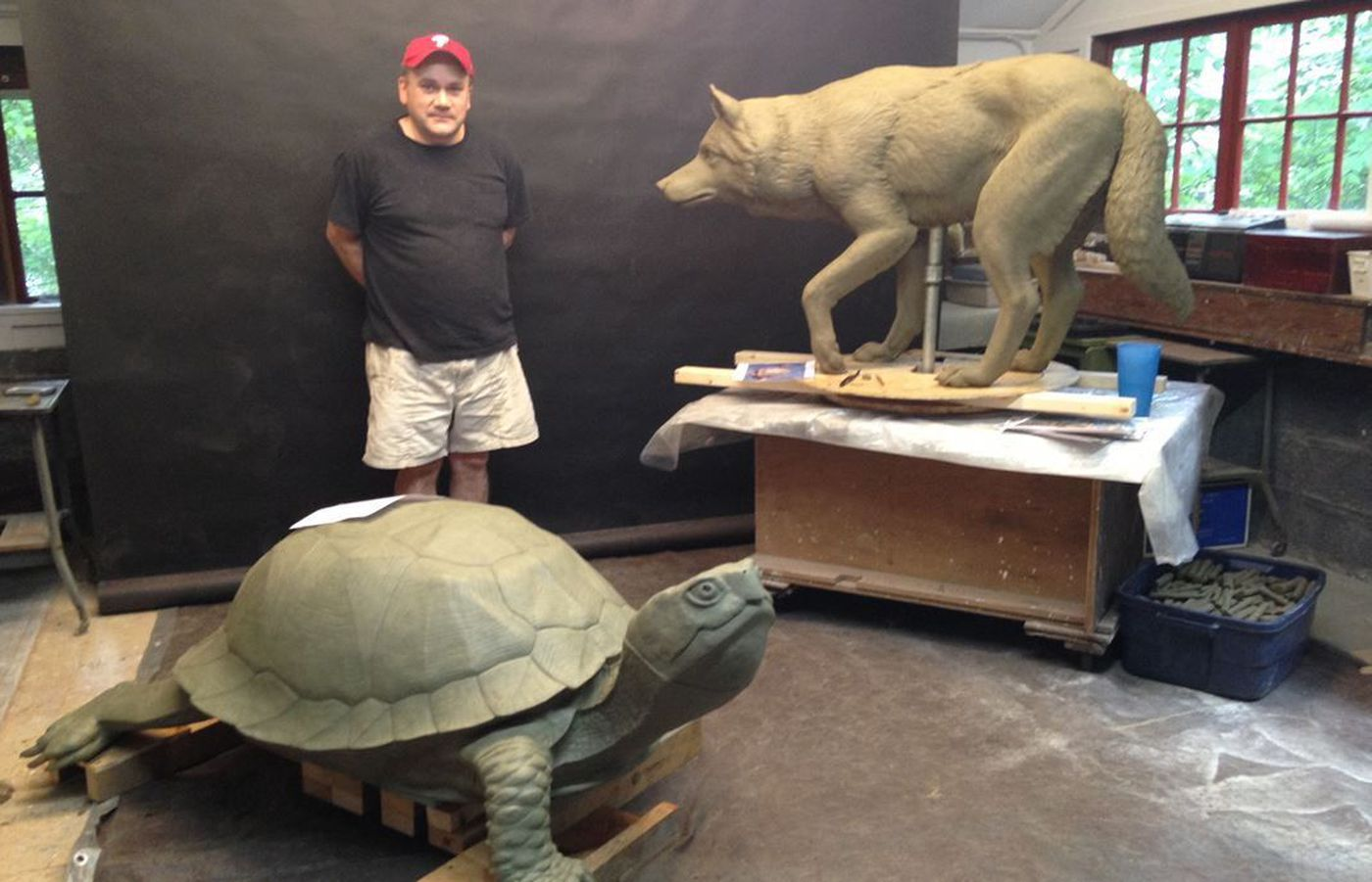 COURTESY OF DONALD LIPSKI   Philadelphia-area artist Chris Collins stands with models of two of the seven new animal sculptures in Fishtown.