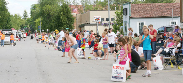 Parade attendees collecting candy.