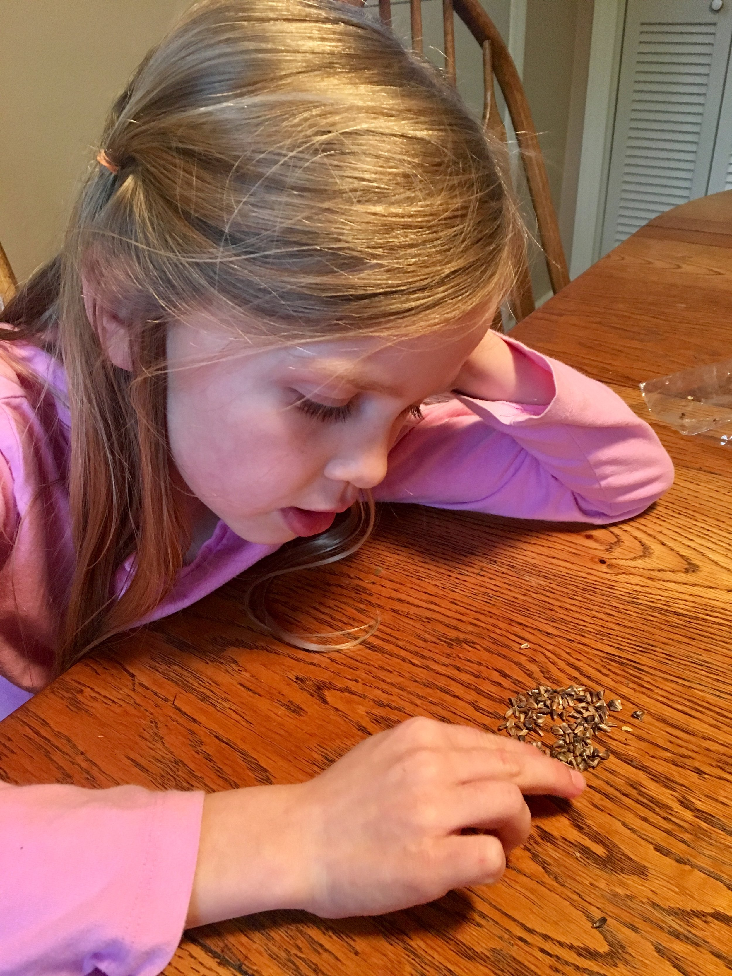 Counting out 10 seeds.